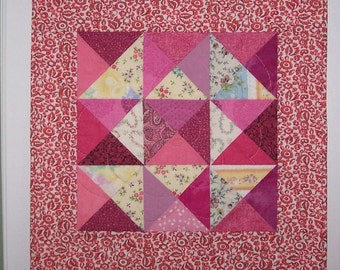 Pink quilted wall hanging or doll quilt