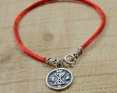 Matching Amulet on Red String Bracelet