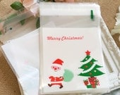 Plastic bags - 20pcs Santa and the Christmas tree bags with 20pcs of christmas tree stickers  (Package treasury)