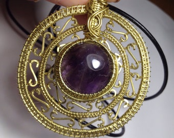 Amethyst in brass shield amulet with leather cord