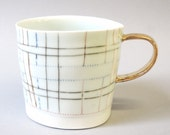 Gold handle - porcelain cup with translucent bottom
