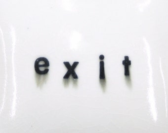 exit -  small porcelain wall pillow