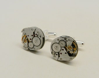 Steampunk cuff links with vintage watch movement.