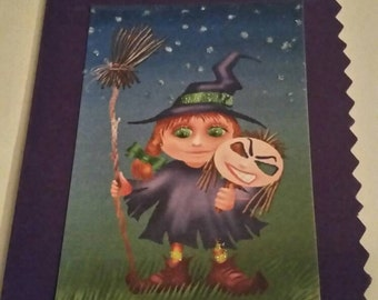 Halloween masquerade witch card.