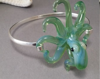 Pearl Green  Octopus Bracelet with heart shapes formed on side tentacles mounted on a Silver cuff braclet