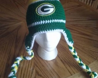 Olivia Grace Nolan loves GreenBay Packers NFL braided earflap Hat Pom Pom