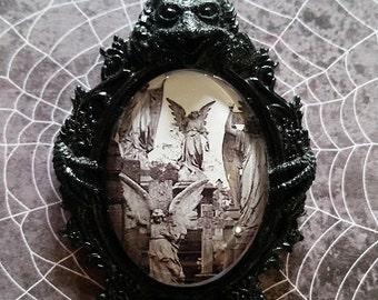 Cemetery Angels set in a Gargoyle setting Brooch/Pin