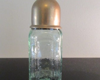 Old aqua glass bottle with screw top and brass cap- beautiful, air bubbles in glass, no chips or cracks, solid, functional