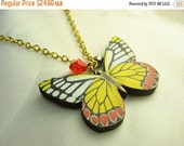 Yellow butterfly necklace ... wooden butterfly pendant with matching Swarovski crystal ... fluttery and free