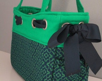 Large shoulder handbag fashioned in classic navy and teal green, ribbon detail