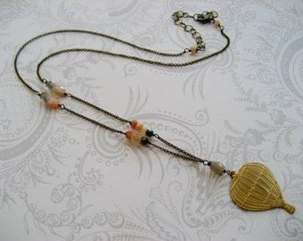 Cate Necklace - long necklace with a hot air balloon charm and moonstones on vintage brass