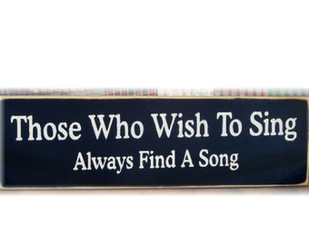 Those who wish to sing always find a song primitive wood sign