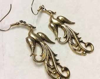 Gold metal drop dangle bird of paradise earrings. Nice!