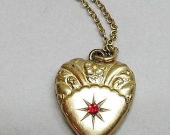 Gold Filled Antique Locket with a Red Starburst by SKM CO