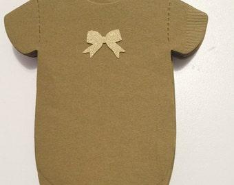 Napkins!  Shaped like baby shirts or bibs! Gold bow baby shower napkins.