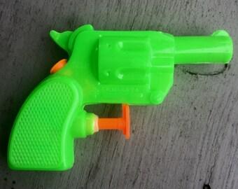 1970s Green Six-Shooter Squirt Gun