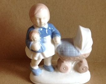 VIntage Figurine -- a Girl, her Doll and a Carriage