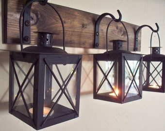 SALE Black lantern trio wall decor. Wall sconces, housewarming gift, bathroom decor, wrought iron hook, rustic wood boards