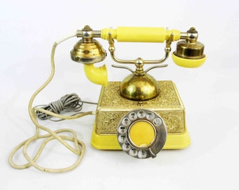 Vintage French Style Rotary Phone with Ivory Body and Brass Accents. Circa 1970's.
