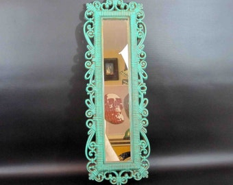 Vintage Sea Foam Green Mirror with Filigree Frame. Circa 1970's.