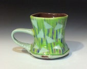 Bright lime green pastel blue and purple stripes triangle shapes mug