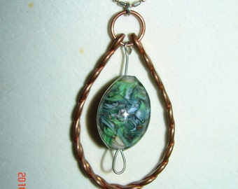 Necklace made of copper, handmade glass bead, and sterling silver