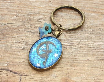 Magical Mystical Fairy Themed Keyring Bag Charm Lucite Blue Flower Beads and a Sparkly Mixed Glitter Star Background Bronze Fairy Moon Charm