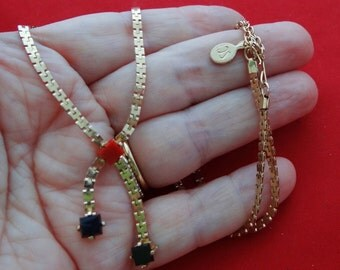 "Vintage SARAH Coventry signed 18""necklace with lariat styling and red and black bead accents in great condition"