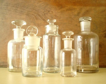 5 antique apothecary jars, clear glass, ground glass stoppers, authentic 1900s pharmacy bottles, Pyrex, scientific industrial collectibles