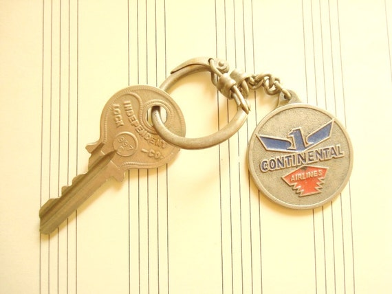 Continental Airlines vintage keychain, Viscount jet fleet, Independent Lock Co. key, mid-century door key and aviation souvenir