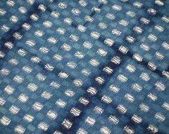 Open weave indigo shibori table mat