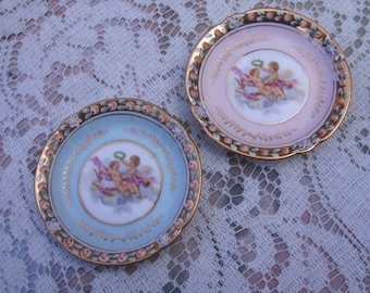 Two Vintage Pink and Blue Miniature Porcelain Cherub Cupid Plates