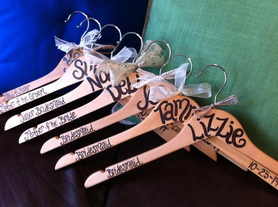 hand painted and personalized wood hangers for weddings, brides, bridesmaid gifts, flower girls, mother of the bride, and even groomsmen