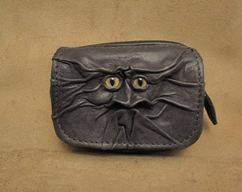 Grichels leather belt pouch - dark greenish black with honey brown and green slit pupil bobcat eyes