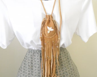 Leather suede side out drawstring medicine bag carved MOP phoenix