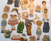 collection of antique paper dolls with outfits and pets