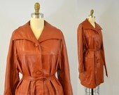 Leather trench coat 1960s mod rust red rocker autumn fashion rusty rock and roll brown IngridIceland vintage