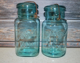 Set of Two Blue Mason Wire Side Canning Jars, One Square Bottom Quart and One Round Bottom Quart Jar.