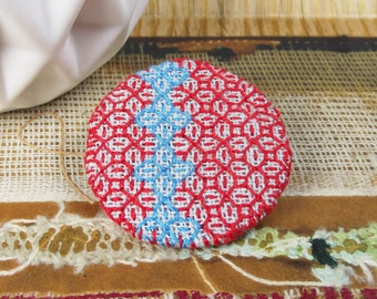 Red and Turquoise Blackwork Pattern brooch. Linen