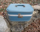 Vintage train case overnight case make up case with keys and mirror inside small blue suitcase for travel display photo prop wedding venue
