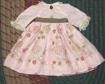 Gorgeous doll dress in antique fabric, hand embroidered for medium size doll