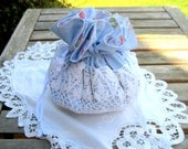 Flower Girl or First communion drawstring purse made with a white vintage doily, blue floral cotton, grosgrain ribbon draw string
