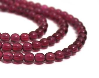 "6mm round Czech Glass Beads, Transparent Fuschia, 11"" bead strand, 50 beads  (1192G)"