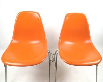 2 Herman Miller Eames bright orange fiberglass chairs