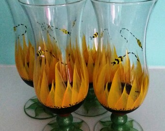 A set of 4 Hand Painted Sunflower and bumble bee glasses