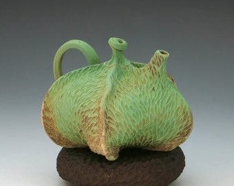 Carved porcelain pod teapot in green, tan & brown with pillow, earthtone, textured