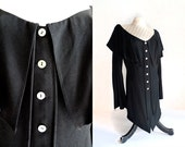 black off the shoulder draped long collar blouse with white buttons . size small