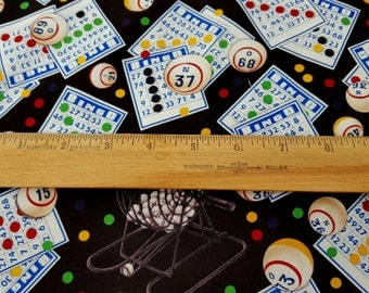 Bingo Cards and Caller Equipment Tossed on Black from the Games of Chance Line on premium cotton fabric by Elizabeth's Studio BTY