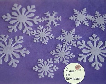 24 Edible snowflakes, wafer paper snowflakes for cake decorating, cupcake decorating, princess cakes, cookie decorating, and winter cakes.