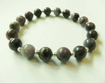 Purple jasper stretch gemstone bracelet with silver coloured seed beads